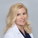 Dr. Natalie May
